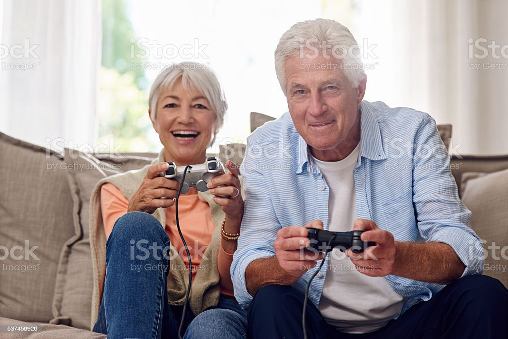 They have so much fun playing video games stock photo