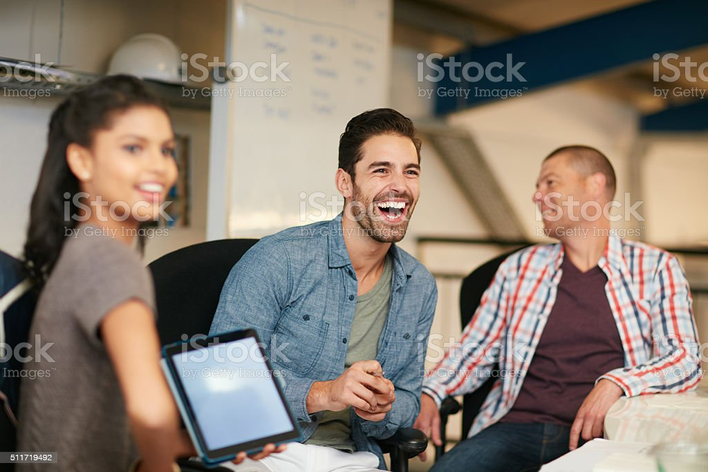 They like to keep things light hearted around the office stock photo