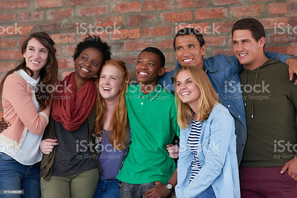 They look like they're enjoying life on campus stock photo