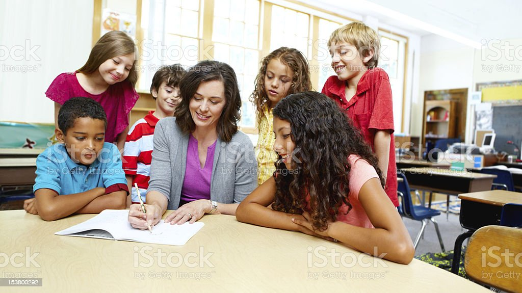 They love listening to their teacher's advice! royalty-free stock photo
