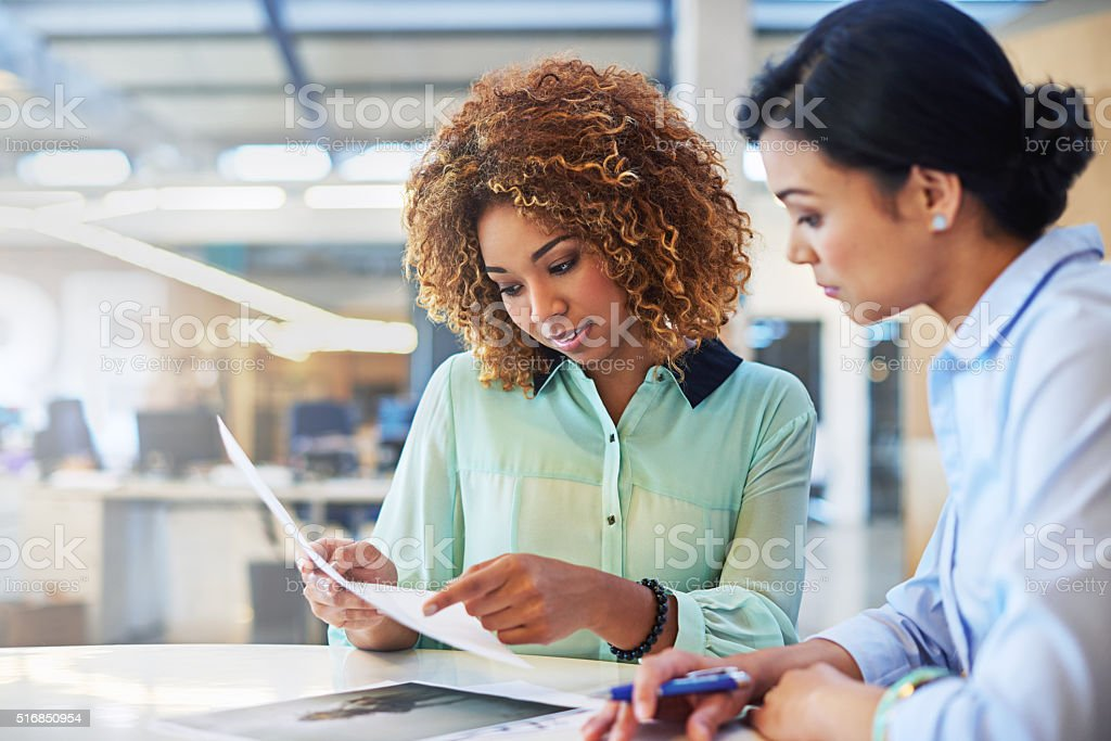 Shot of two businesswoman working together in an office
