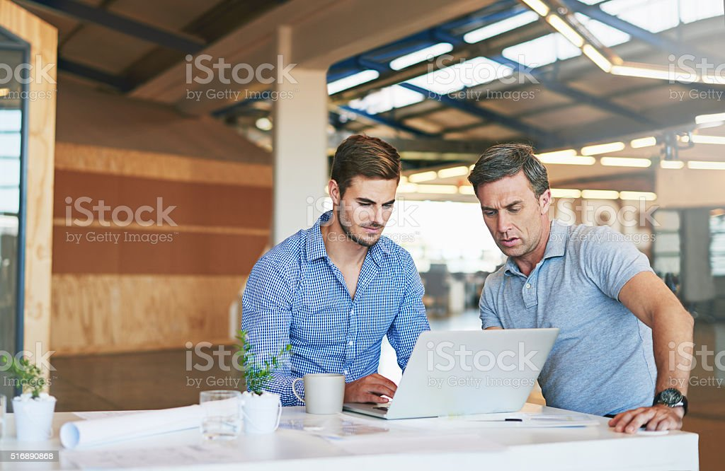 They're focused on the their project stock photo