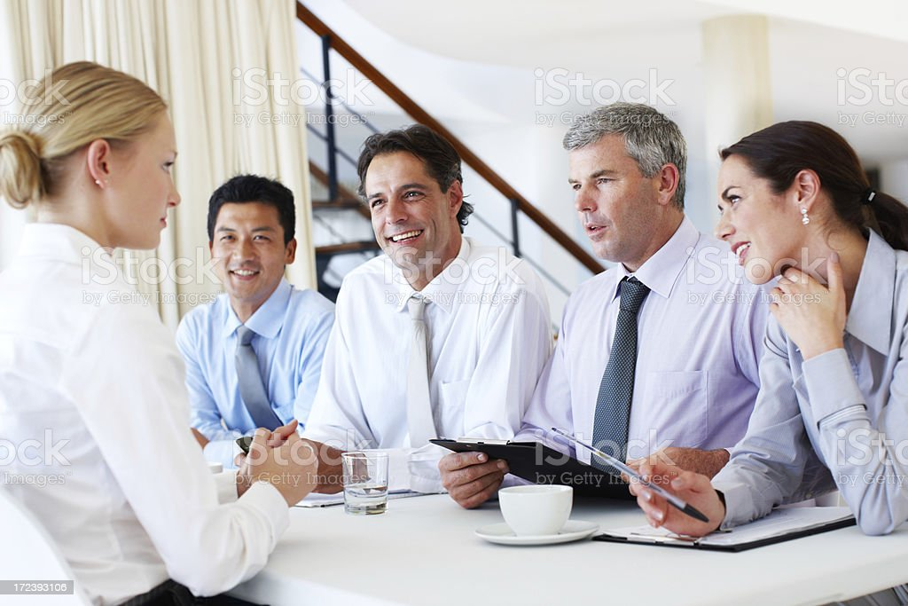 They're hanging on her every word! stock photo