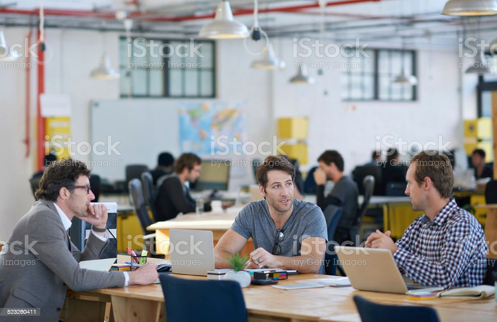 They're the office trifecta of success stock photo