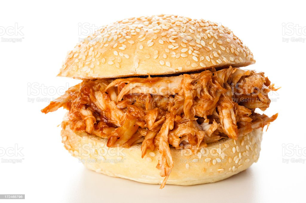 Thick amount of pulled chicken between sesame buns stock photo