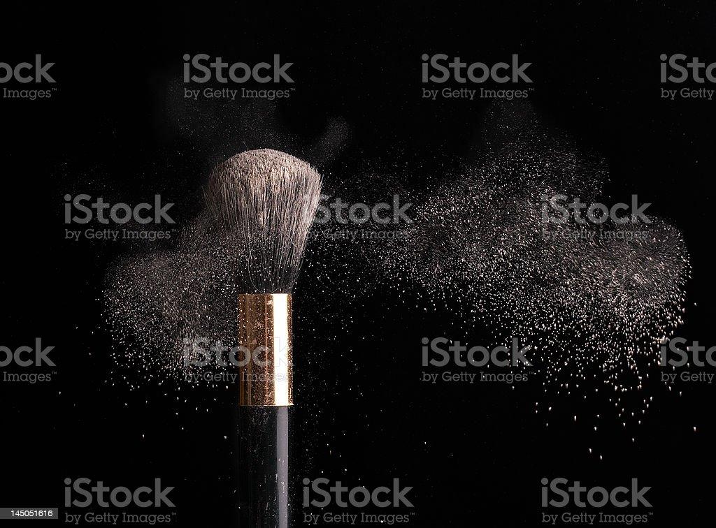 thick black brush and powder dust stock photo