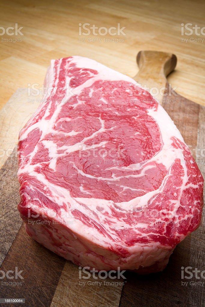 Thick Bone-In Rib Eye Steak stock photo