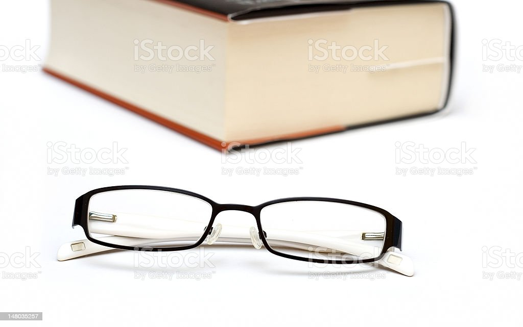 Thick book and glasses stock photo