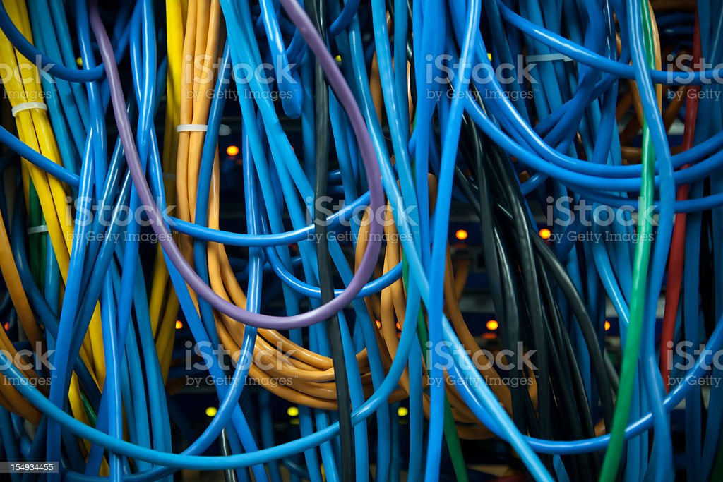 Thick Clusters of Overlapping Colorful Server Ethernet Network Cables Closeup royalty-free stock photo