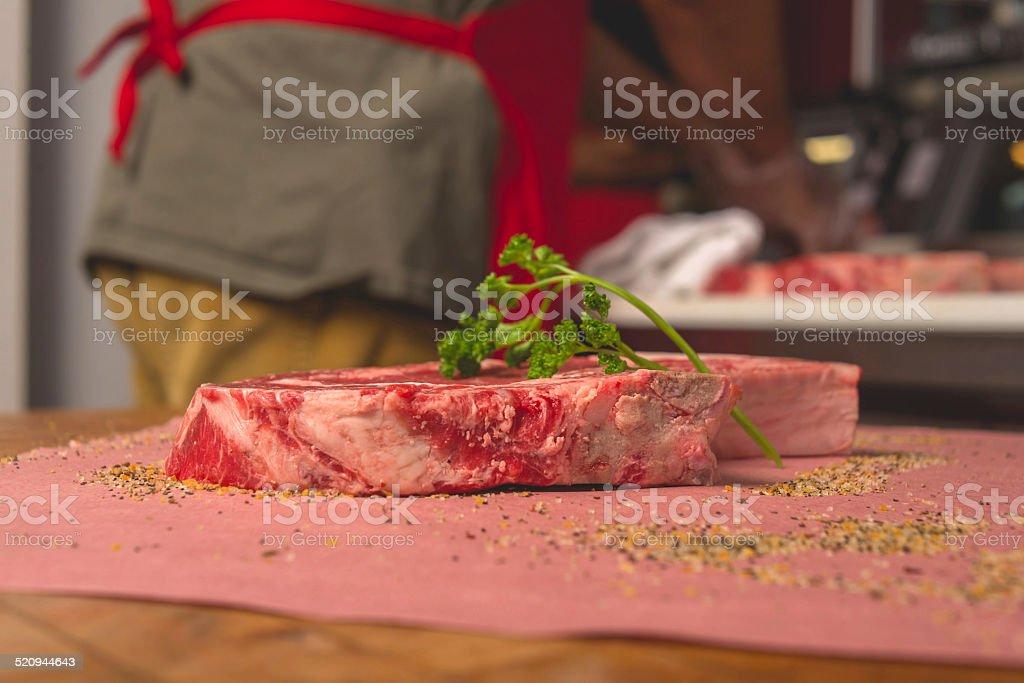 Thick Cut Steak at Butcher Shop stock photo
