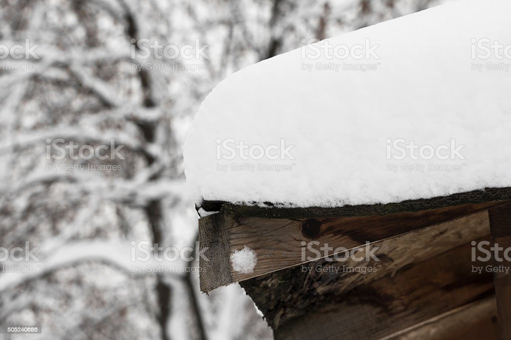 Thick layer of snowdrift on the roof stock photo