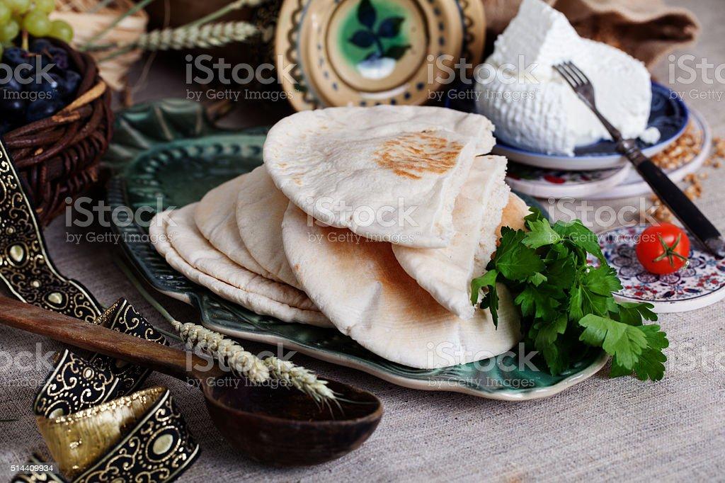 thick pita bread in a still life Israeli style stock photo