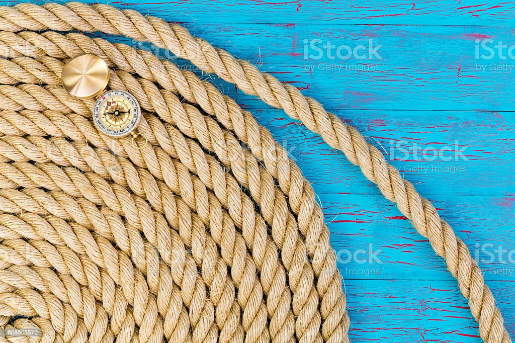 Thick rope and open directional compass stock photo