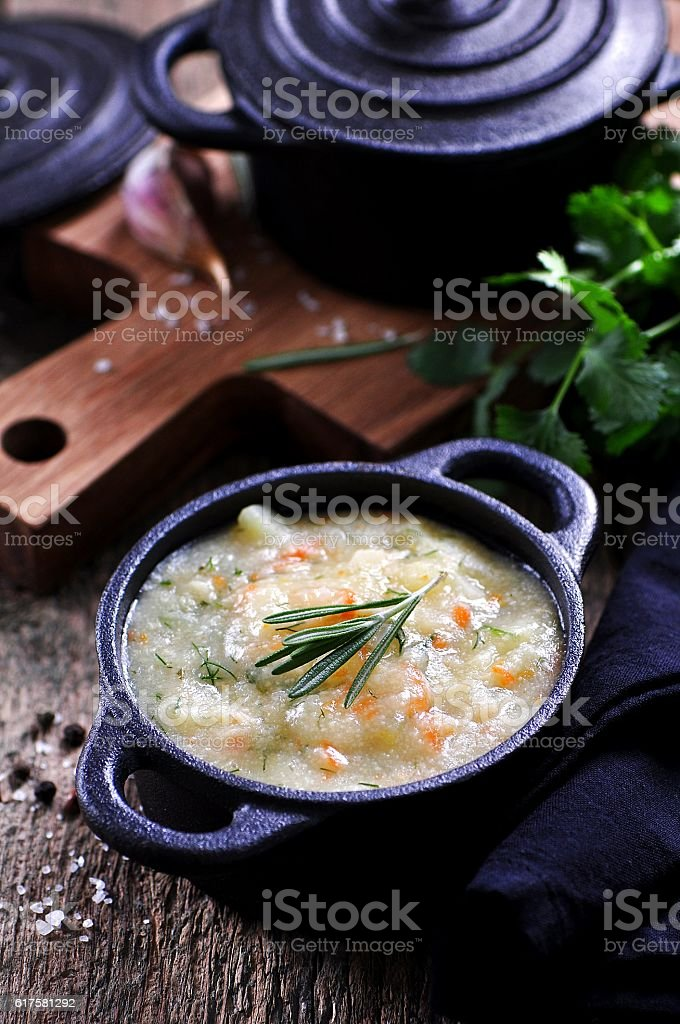 Thick soup of corn grits with potatoes, carrots, garlic, dill stock photo