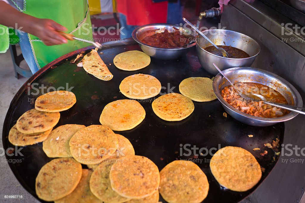 Thick Tortilla Toasting in Outdoor Market in Mexico stock photo