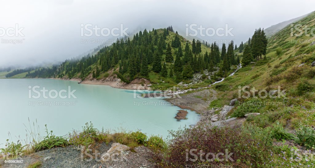 Thick white mist over the Big Almaty Lake stock photo