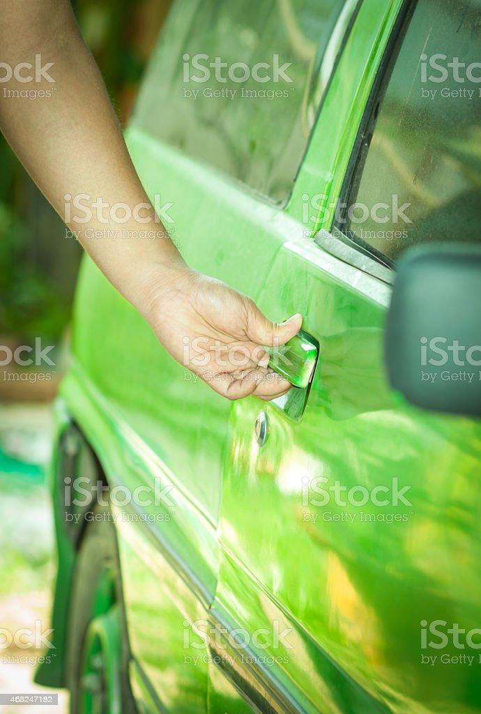 Thief a green car. stock photo