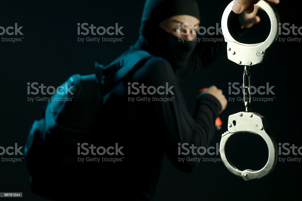 Thief and Handcuff stock photo