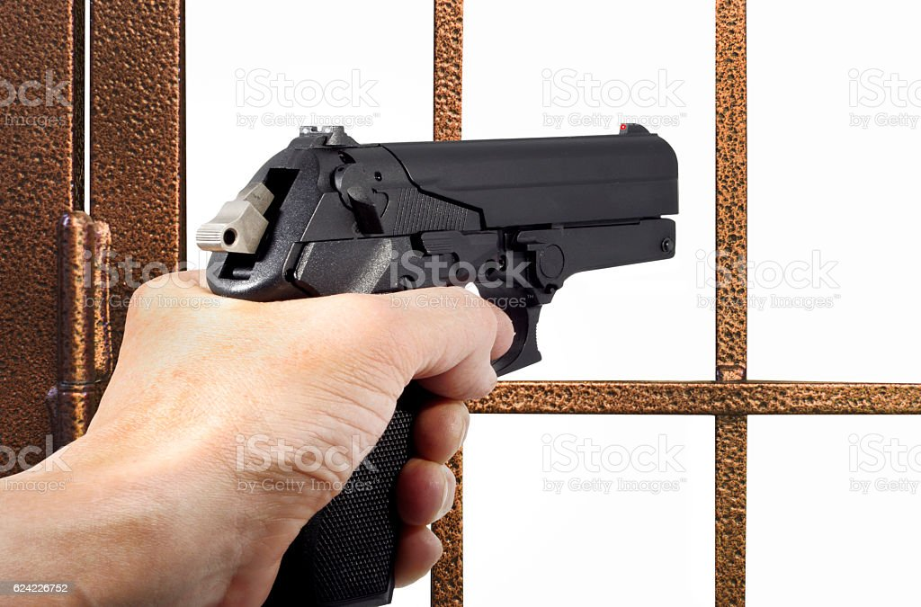 Thief armed with a pistol stock photo