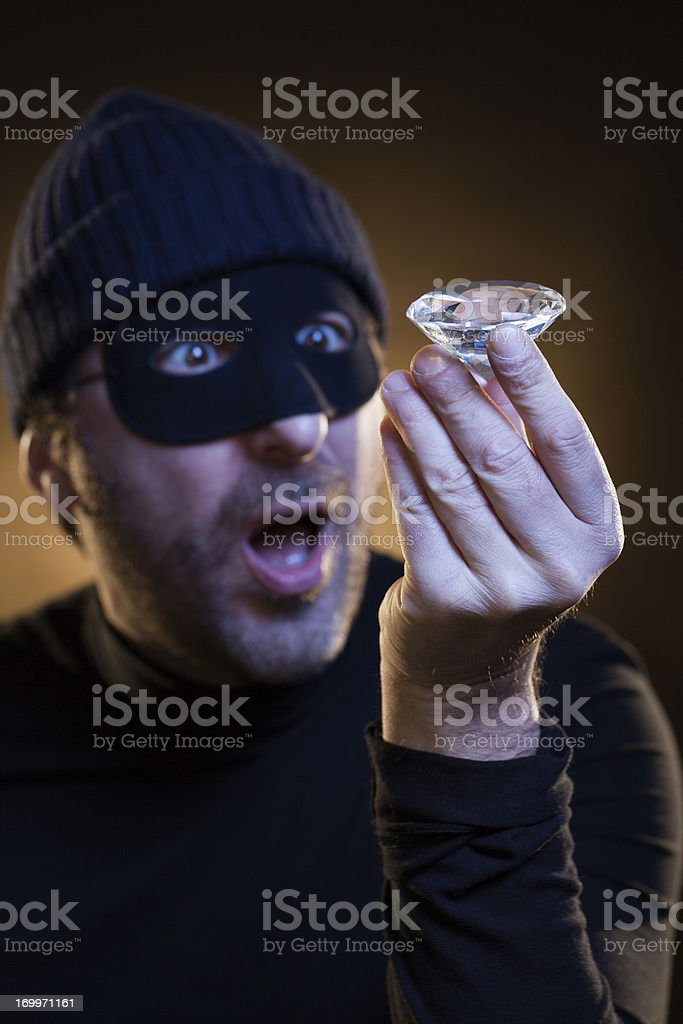 Thief Astonished by His Just Stolen Big Diamond royalty-free stock photo