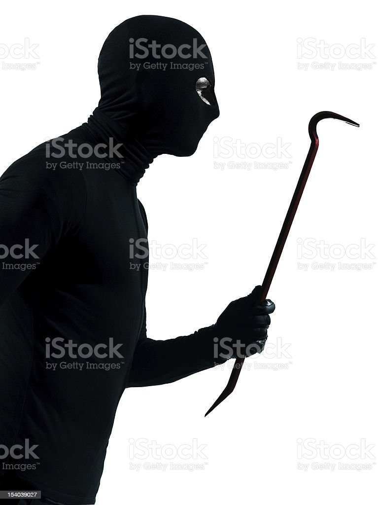 thief criminal holding crowbar portait stock photo