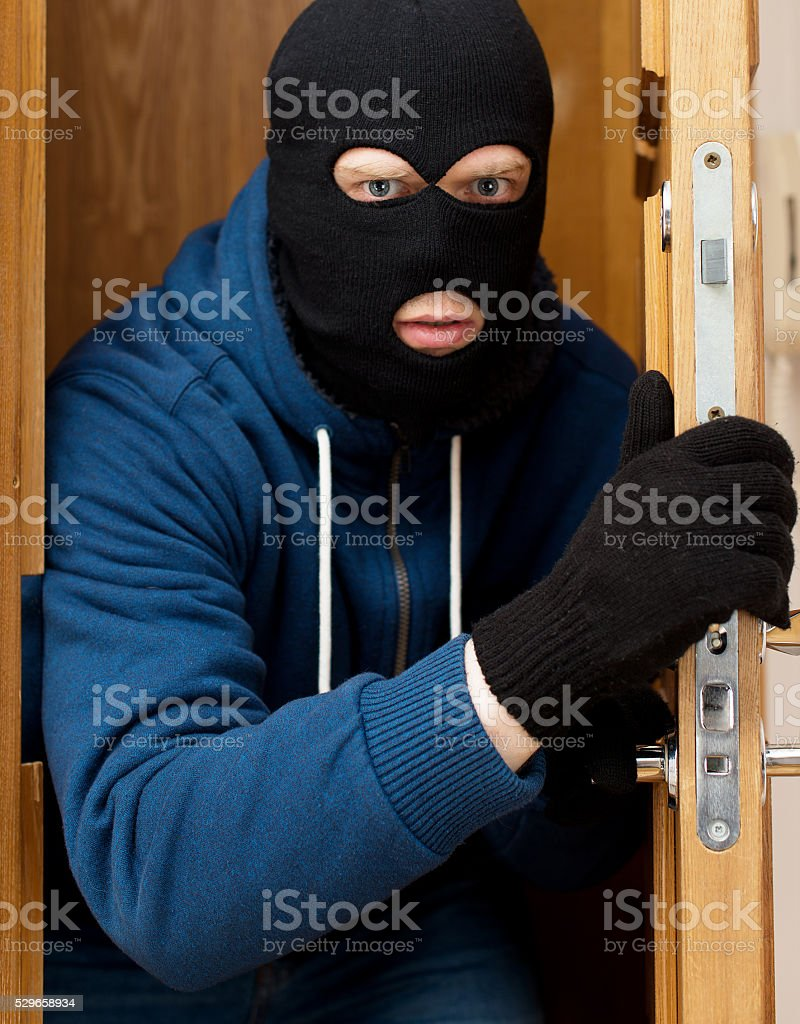 Thief entering the private property. stock photo