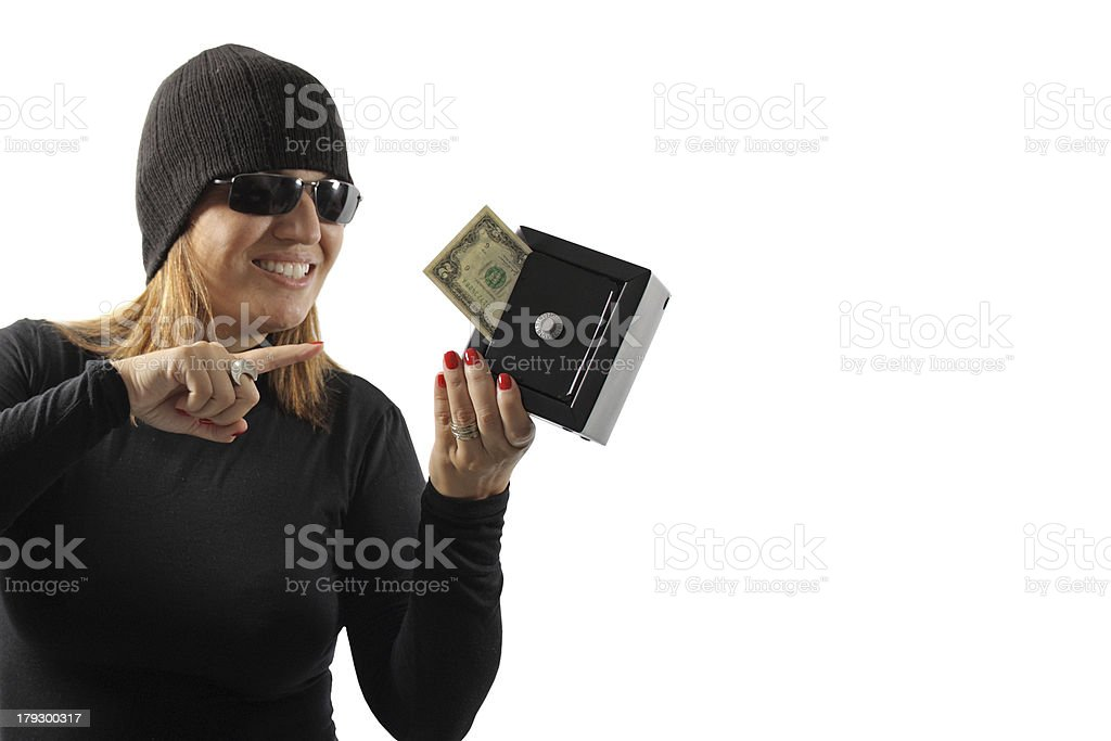 Thief girl holding a safe royalty-free stock photo