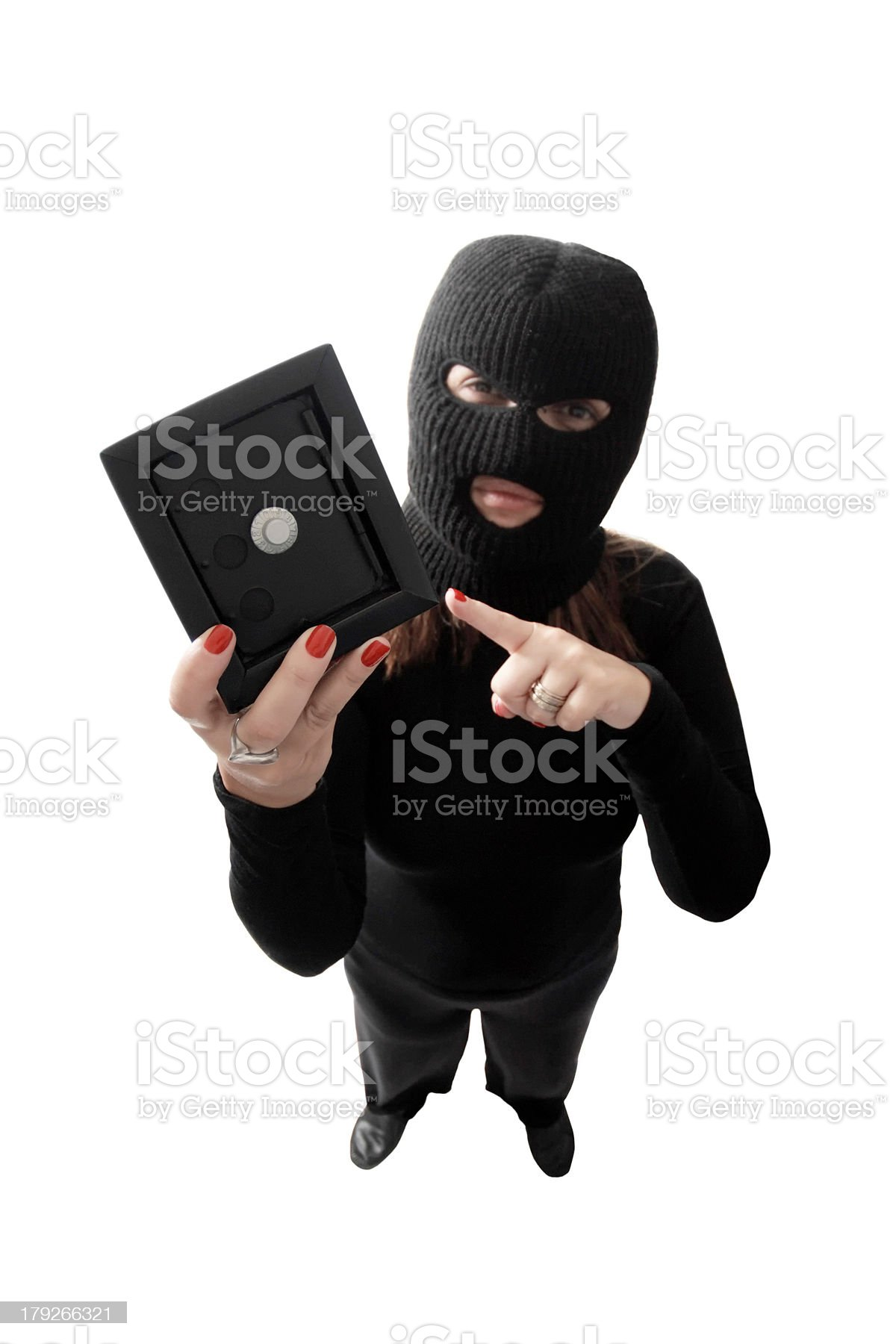 Thief holding a safe royalty-free stock photo