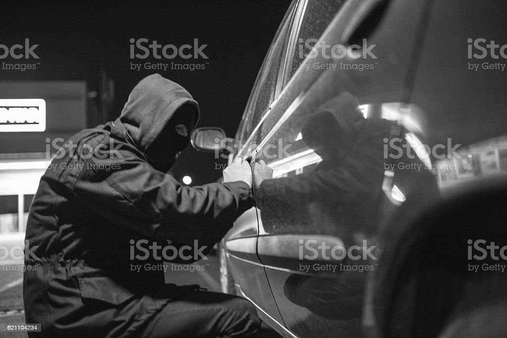 Thief in action stock photo