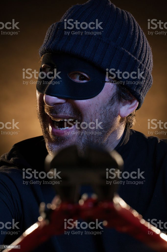 Thief Menacing the Viewer with Nippers royalty-free stock photo