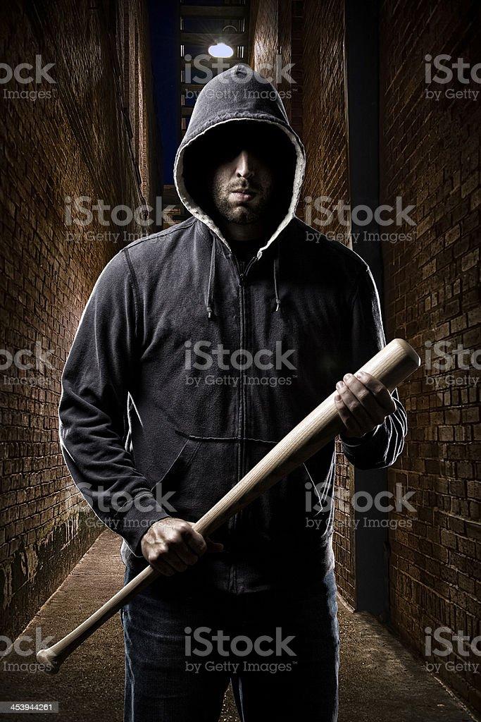 Thief on a dark alley stock photo