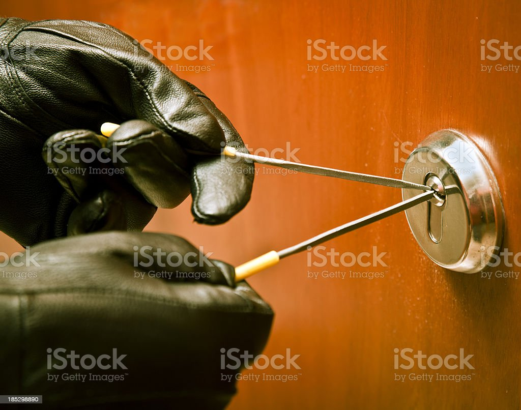 Thief opening a lock with picklock royalty-free stock photo