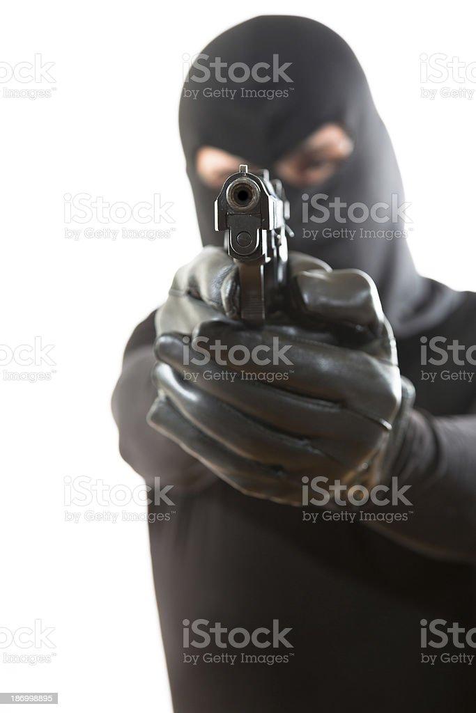 Thief pointing a gun royalty-free stock photo