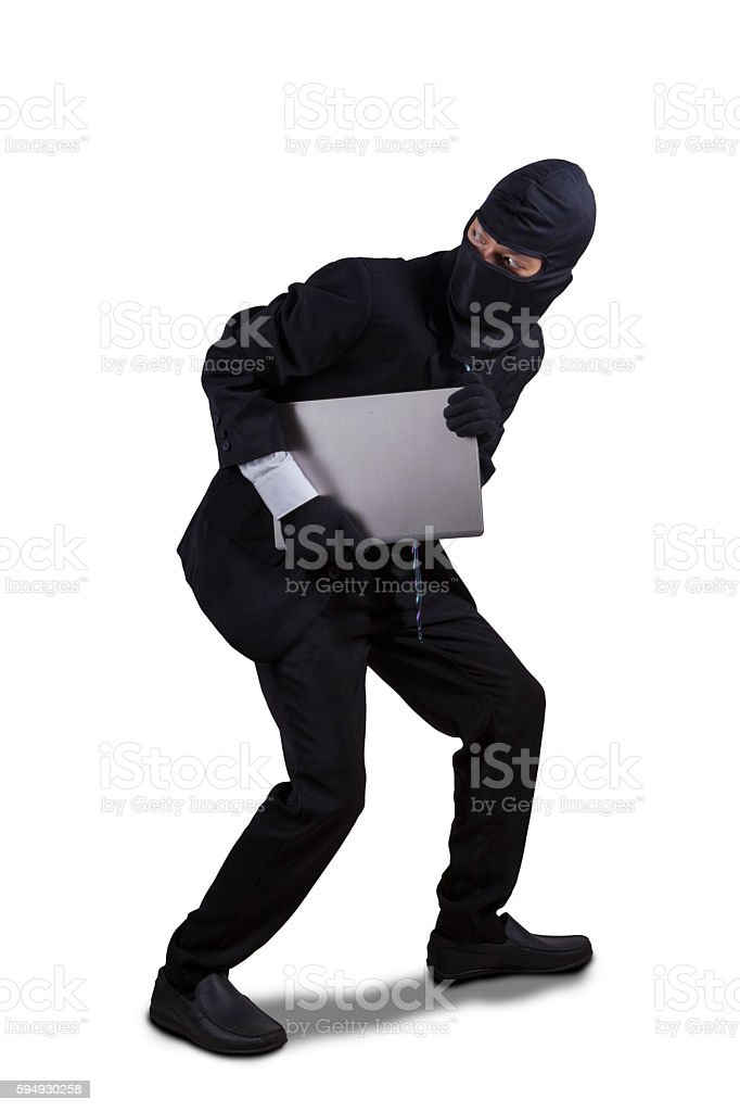 Thief running with laptop isolated stock photo