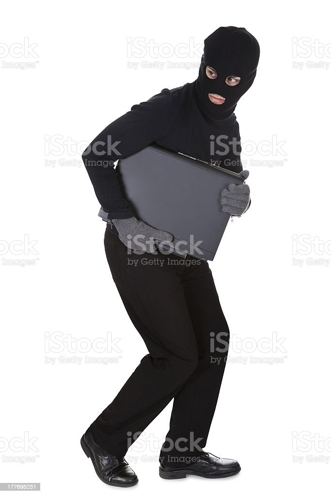 Thief stealing a laptop computer royalty-free stock photo