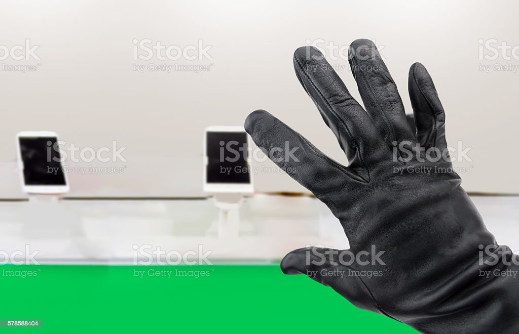 thief stealing a telephone stock photo