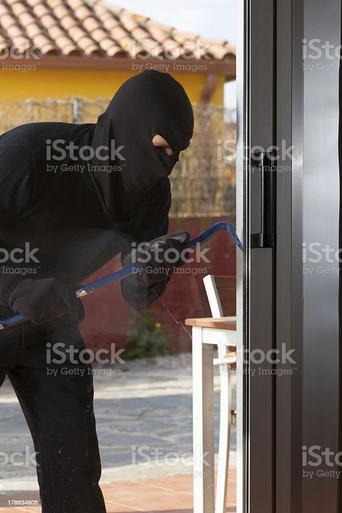 Thief stealing from a house royalty-free stock photo
