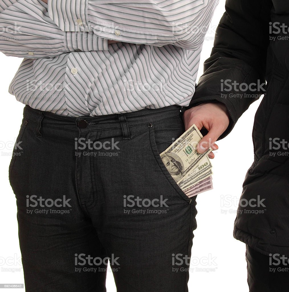 thief steals a purse from man stock photo