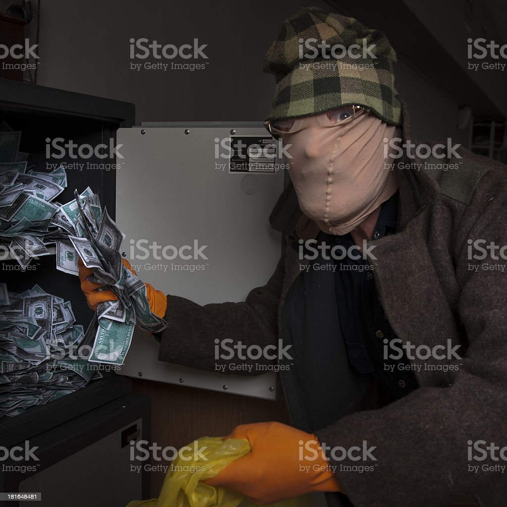 thief steals money from the safe royalty-free stock photo