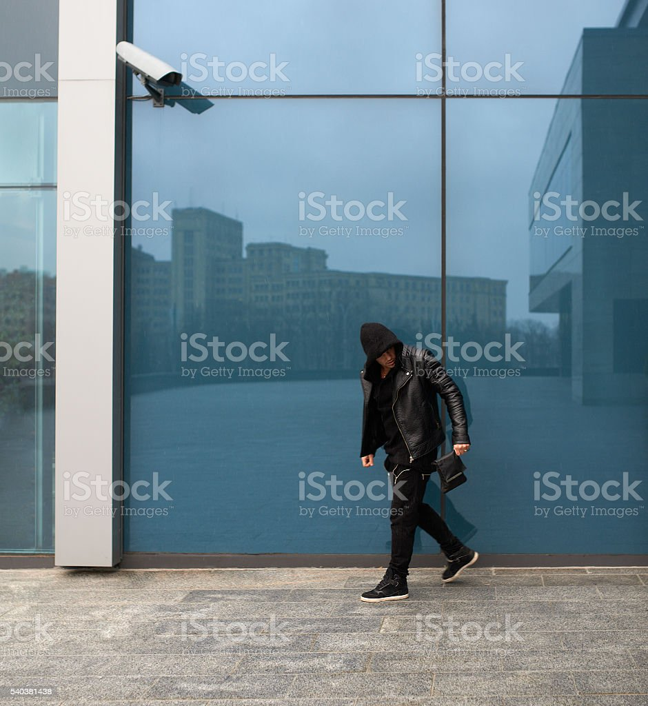 thief stole  purse and runs off stock photo