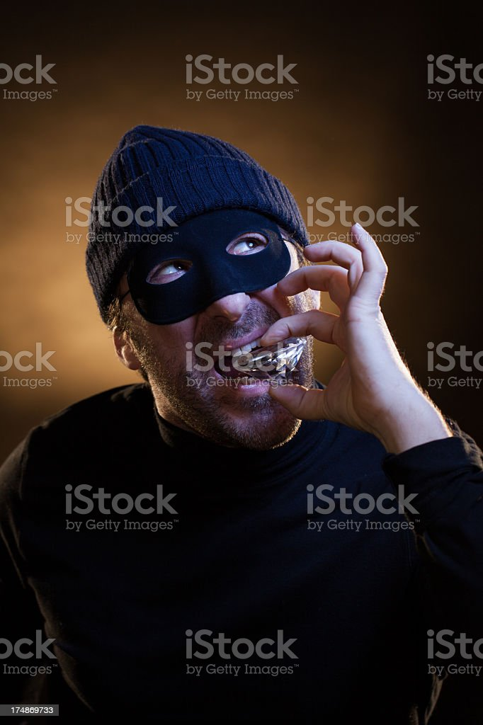 Thief Testing the Purity of a Big Diamond royalty-free stock photo