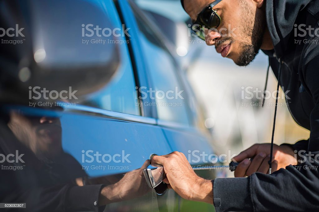 Thief Trying To Break Into A Car stock photo