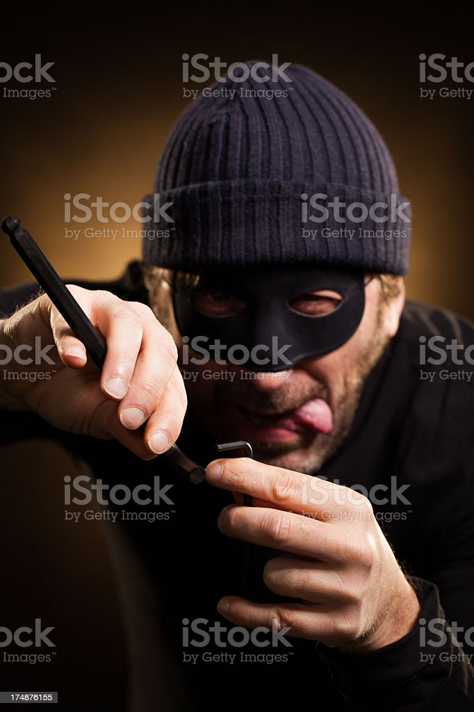 Thief Trying to Open Door with Tools royalty-free stock photo