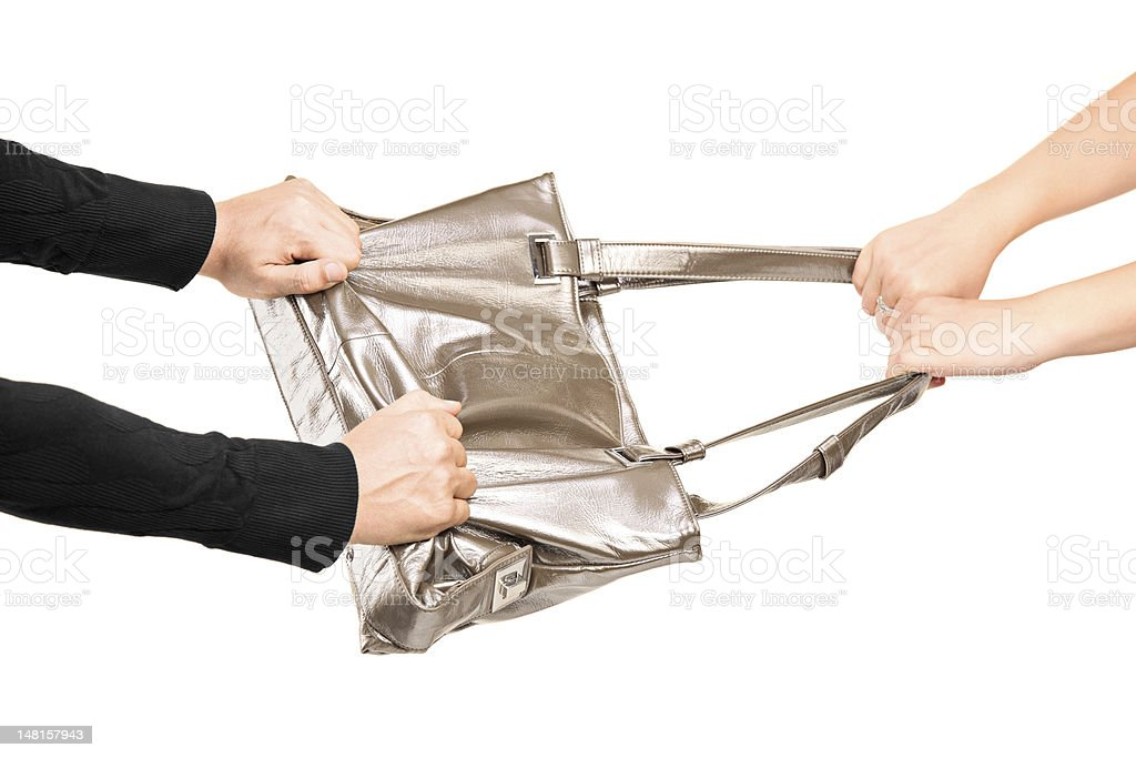 Thief trying to steal a handbag royalty-free stock photo