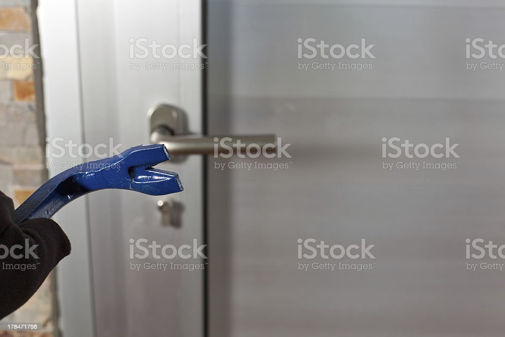Thief with a bar of iron royalty-free stock photo