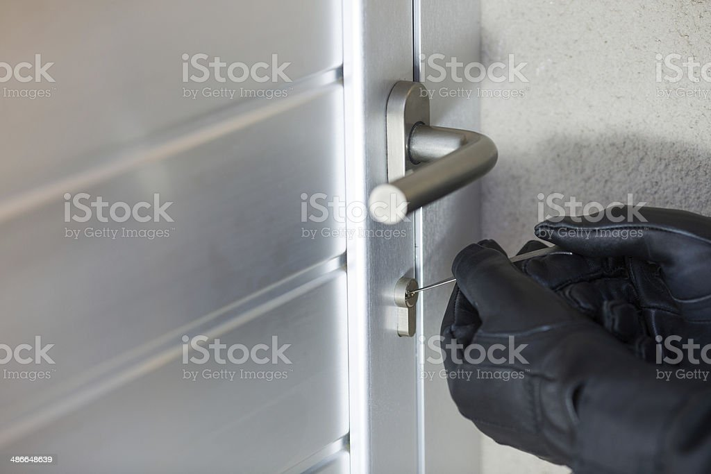 Thief with a bar of iron stock photo
