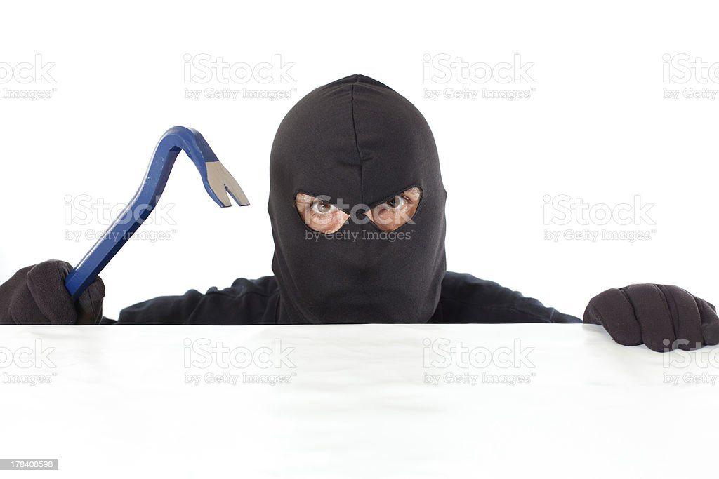 Thief with a bar stock photo