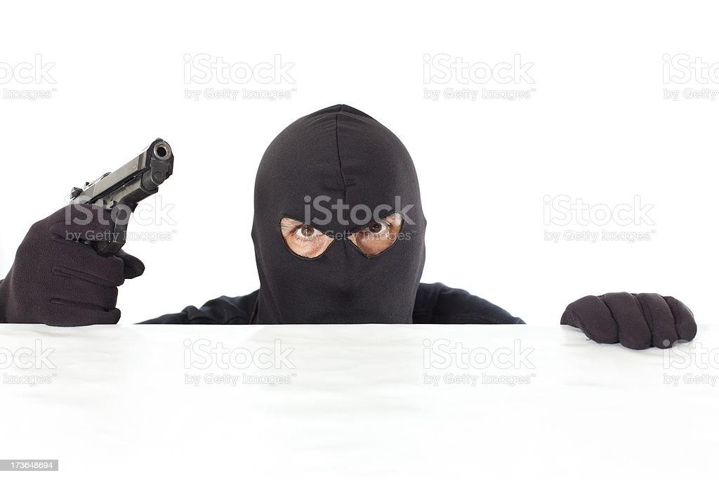 Thief with a pistol royalty-free stock photo