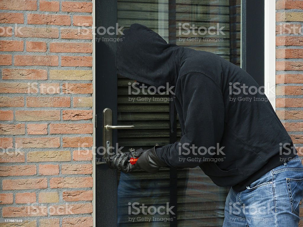 Thief with a screwdriver royalty-free stock photo