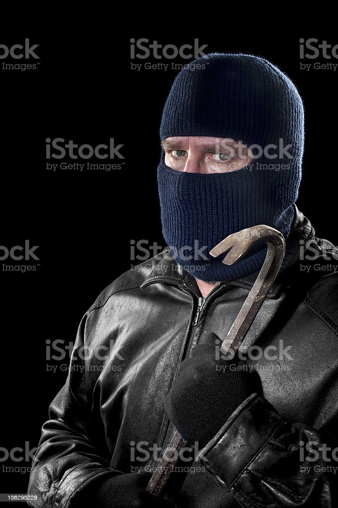 Thief with crowbar stock photo